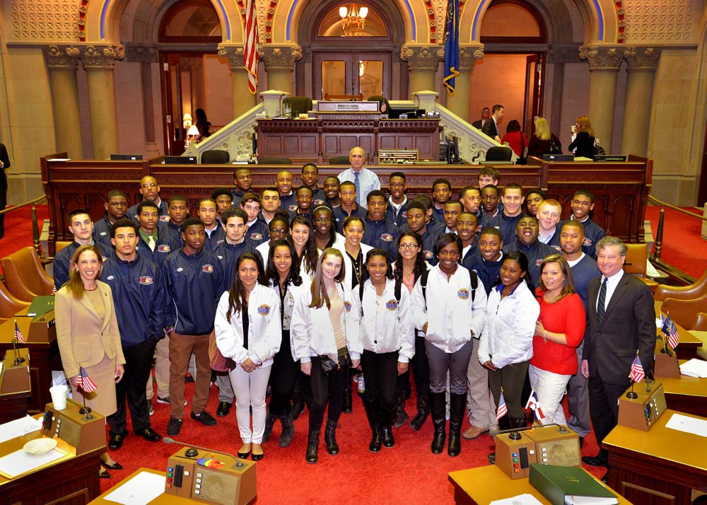 Assemblyman Otis, joined by Assemblywoman Paulin, welcomes the championship football and cheerleading teams of New Rochelle High School and celebrates their outstanding athletic achievements.
