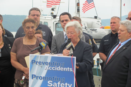 Sandy and Senator David Carlucci are accompanied by Boating Safety advocates at a press conference to support their boating safety legislation.