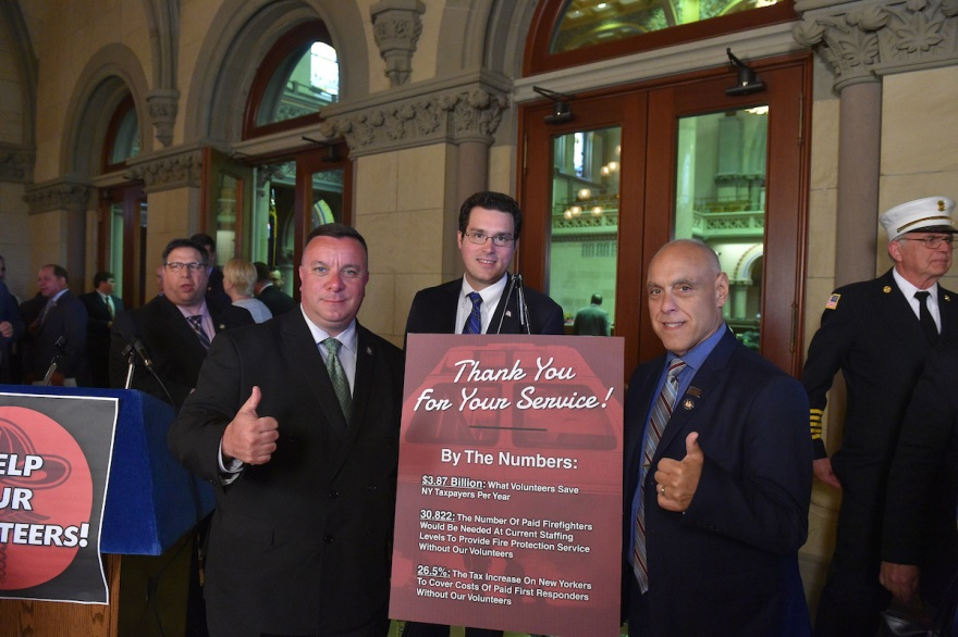 Assemblyman Karl Brabenec (R,C,I-Deerpark) [left] attended a press conference in Albany pushing a tax exemption for volunteer first responders on Monday, May 20, 2019.