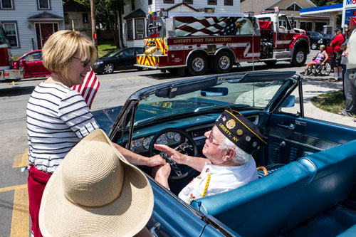 Aileen with a veteran at the 4th of July parade in Liberty.