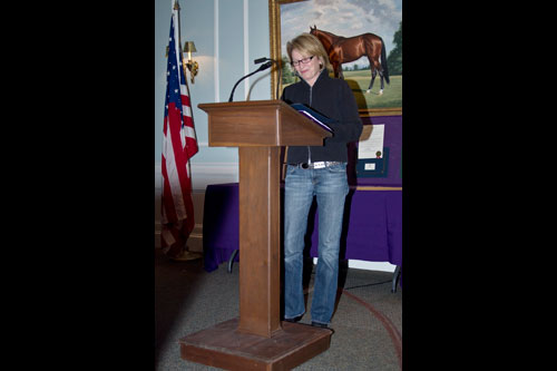 Aileen speaks at an event for Pancreatic Cancer Awareness at the Goshen Harness Racing Museum.