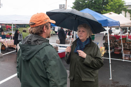 Assemblymember Didi Barrett with Claverack farmer Chris Cashen at the Hudson Farmers' Market on June 2nd, 2012