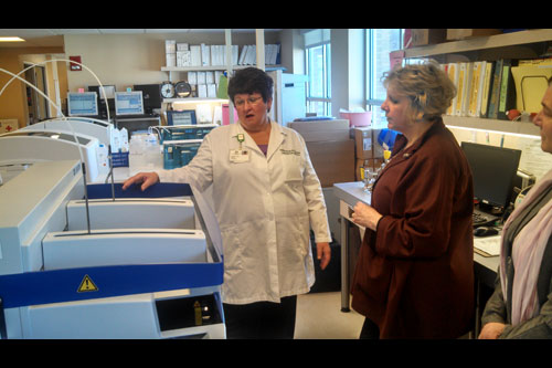 Barrett talking with Dawn Perlin, Laboratory Dir. for Columbia Memorial Hospital, in front of equipment specifically used to test for Lyme disease. Columbia Memorial Hospital has some of the most advanced testing equipment for lyme disease in the country.