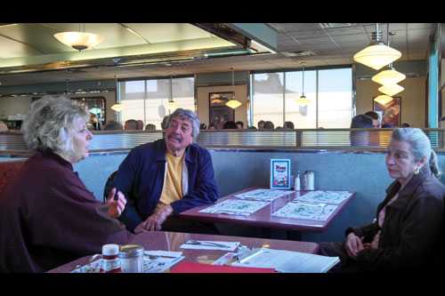 Barrett speaking with Anne and Adolfo Fecci from Gallatin during her recent mobile district office Diner Stop at the Plaza Diner in Greenport.
