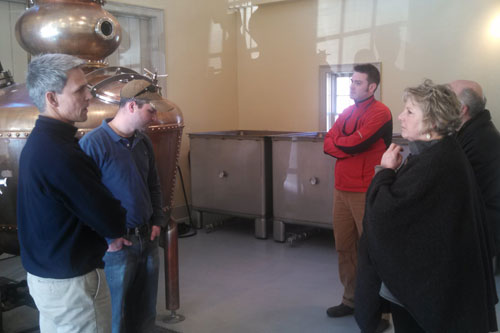 Barrett talking to Jeff Baker, owner of Hillrock Estate Distillery in Ancram, during one of the stops in her �Where the Jobs Are� Tour.