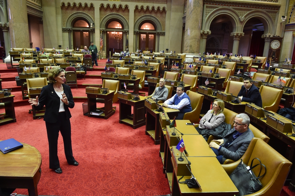 Assemblymember Fahy welcome visitors from Albania on the Assembly chamber floor during their tour to learn more about democracy and civil society.