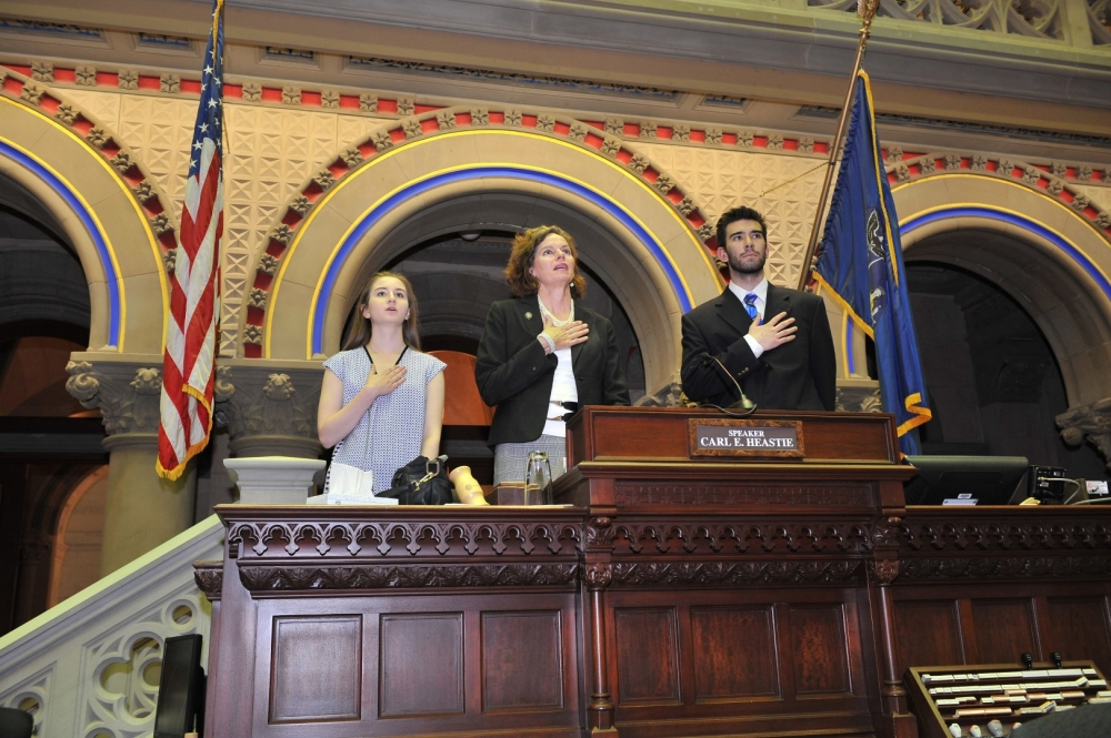 Summer Interns Molly Ketter of Albany and Zack Malitz of Guilderland join Assemblywoman Fahy in �gaveling� in. The Assemblywoman, as the resident representative from Albany, continues the tradition of