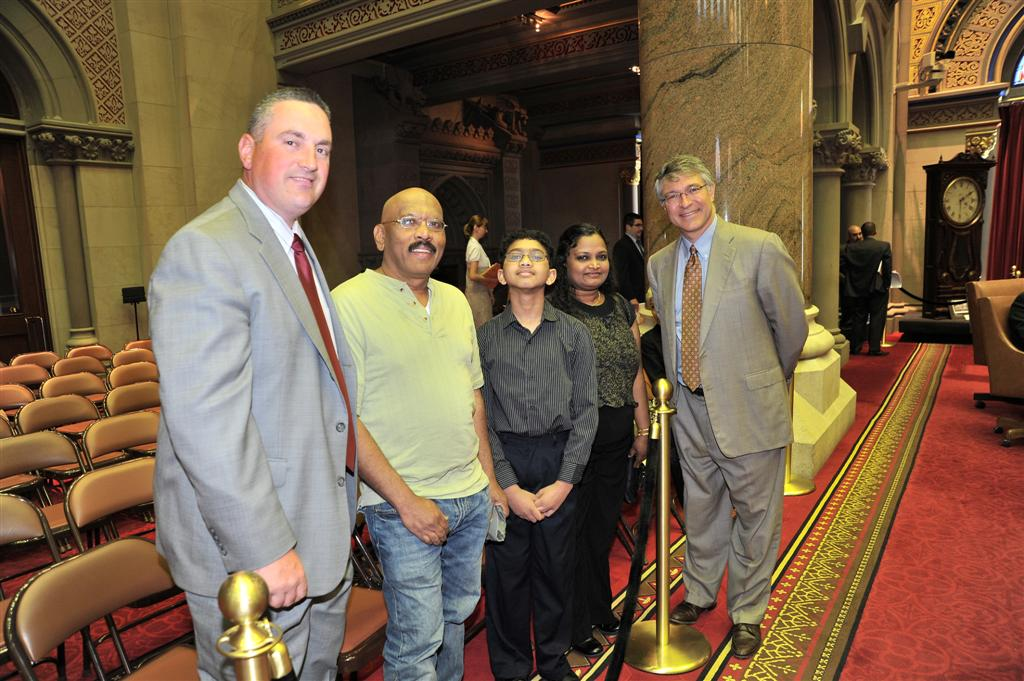 Assemblymember Phil Steck welcomes Ryan Devanandan, Scripps Capital Region Spelling Bee Champion and National Spelling Bee contestant, along with his parents, Anita and Moses Devanandan, and Sand Cree