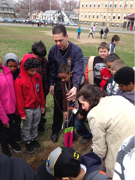Assemblyman Angelo Santabarbara helps students plant trees on Earth Day at Lincoln Elementary School in Schenectady.