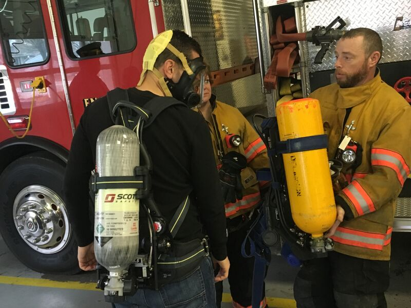 Assemblyman Angelo Santabarbara learns how to use one of 10 new self-contained breathing apparatus at the Delanson Volunteer Fire Department. He helped the department secure more than $50,000 to make the lifesaving equipment upgrade. 11/5/2015
