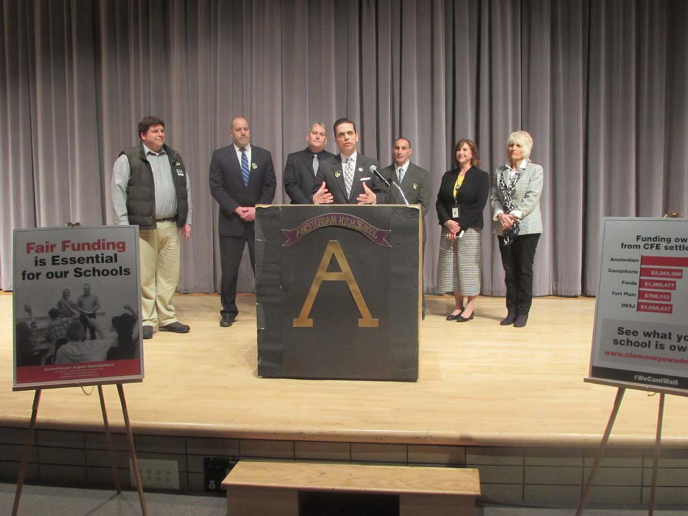 Assemblyman Angelo Santabarbara is joined by Montgomery County school superintendents, students and statewide education advocates in calling for fair funding and an end to the Gap Elimination Adjustment during a press conference Thursday, March 10, at Amsterdam High School.