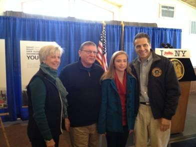 Assemblyman Ken Blankenbush (R,C,I-Black River), his wife, Sheila, and his granddaughter, Claire, join Gov. Cuomo at an event held at the Ridgeview Inn in Lowville where the assemblyman spoke about the importance of winter tourism to the North Country and upstate New York.