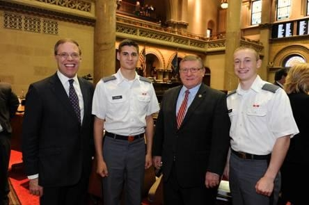 Assemblyman Ken Blankenbush (R,C,I-Black River) (center-right), joined by Assemblyman Will Barclay (left), welcomes Cadets Nicholas J. Tyler and Brandon A. Lloyd at the annual West Point Day ceremony at the State Capitol.