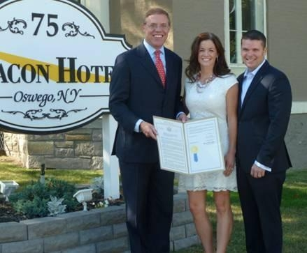 Assemblyman Barclay, left, presented Tom and Falecia Avery with an Assembly resolution. The couple was awarded a Small Business Excellence Award for the Beacon Hotel.