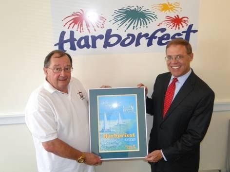 Doug Buske, Executive Director of Harborfest, left, presented Assemblyman Will Barclay (R,C,I�Pulaski) with a framed print of the official Harborfest poster and brochure cover.  The winning design was