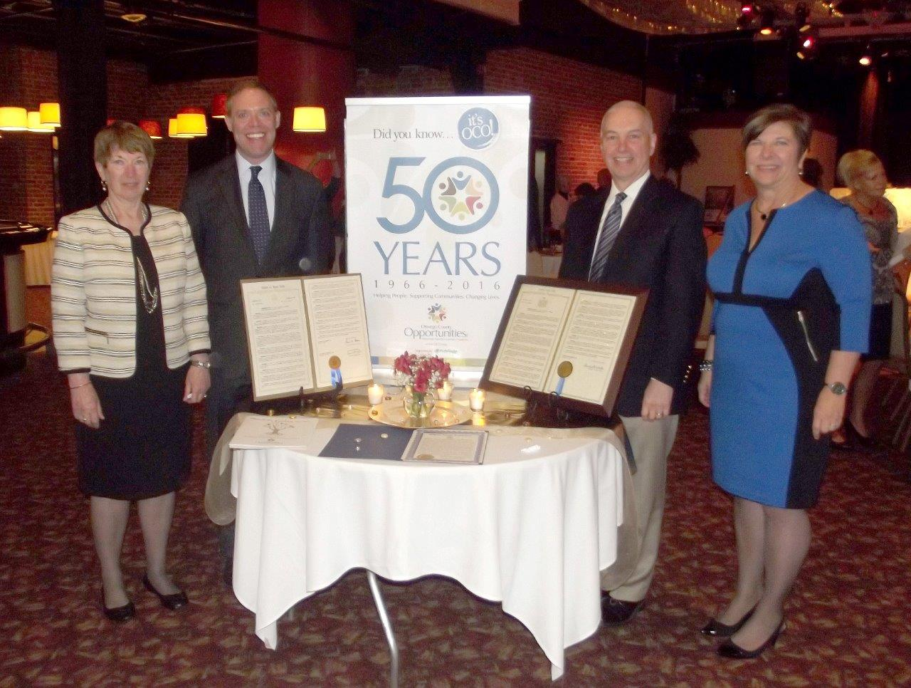 Assemblyman Will Barclay (R,C,I--Pulaski) and Assemblyman Bob Oaks (R,C—Macedon) recently congratulated Oswego County Opportunities on celebrating its 50th year anniversary at the organization's annua
