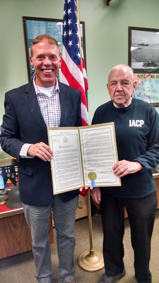 "Assemblyman Will Barclay presented Alan ""Dick"" Deline, right, with an Assembly Resolution commending his military service."