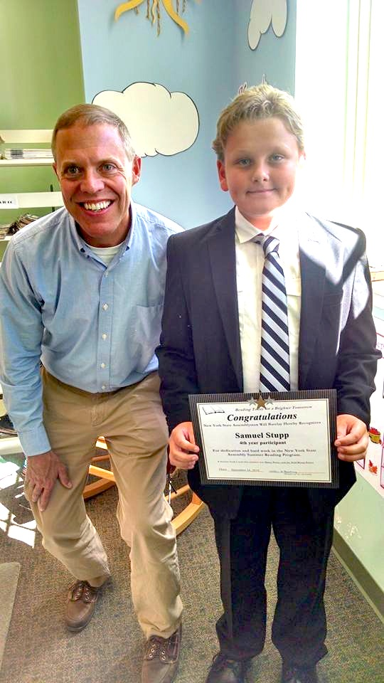 Samuel Stupp of West Monroe pictured with Assemblyman Barclay was the first reader this year to turn in his completed summer reading challenge.