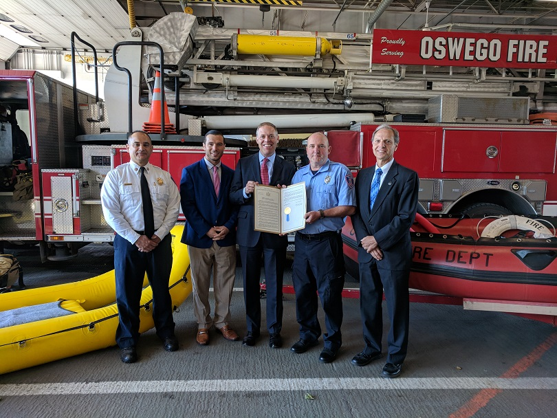 Assemblyman Will Barclay (R,C,I,Ref-Pulaski) presented Oswego Fire Fighter Sean O'Gorman with an Assembly resolution commemorating his recent act of bravery and successful water rescue.