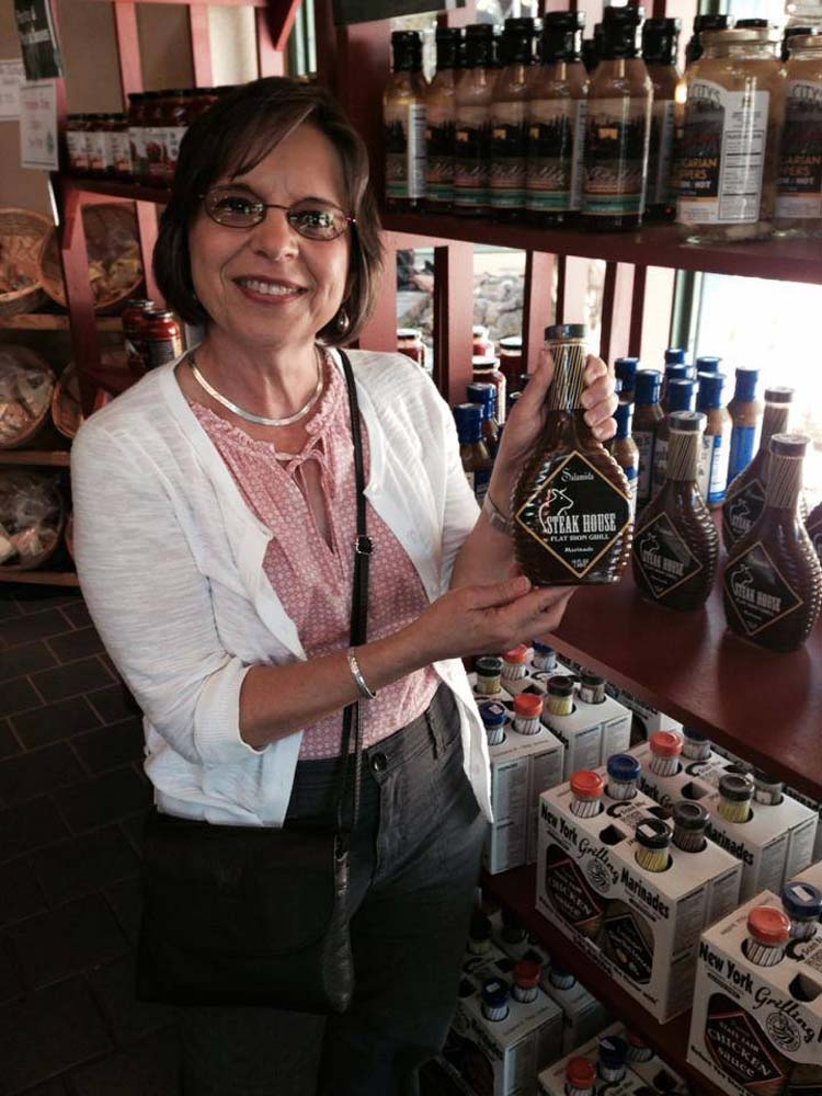 August 29, 2014 � Assemblywoman Lupardo finds a bottle of sauce for the Southern Tier�s signature delicacy, spiedies, while visiting the Great New York State Fair.