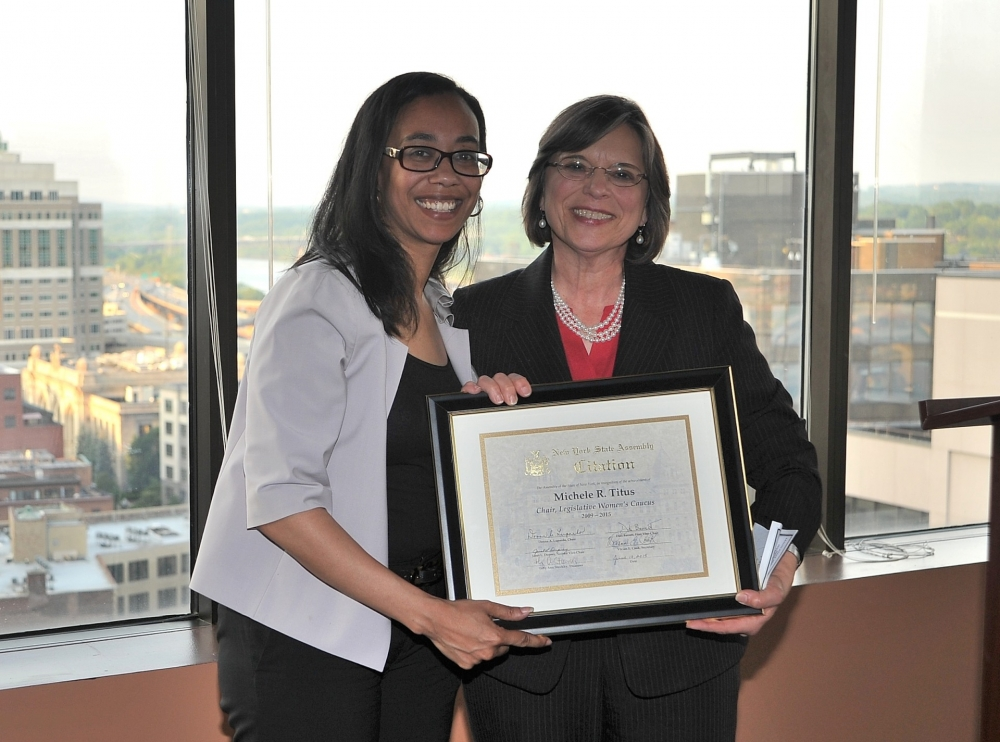 June 10, 2015 � Newly elected Chair of the Legislative Women�s Caucus, Assemblywoman Lupardo, presents outgoing Chair Assemblywoman Michelle Titus with a citation in honor of her work and dedication t