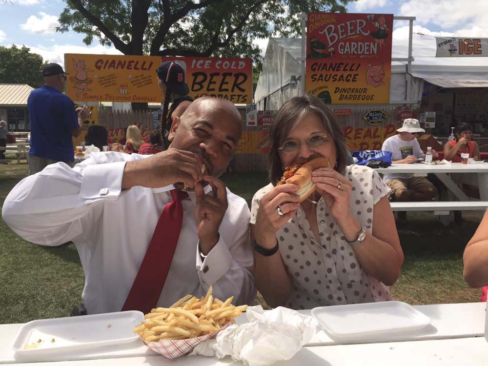 August 28, 2015 – Assembly Speaker Carl Heastie and Assemblywoman Lupardo enjoy a Gianelli sausage sandwich at the Great New York State Fair.