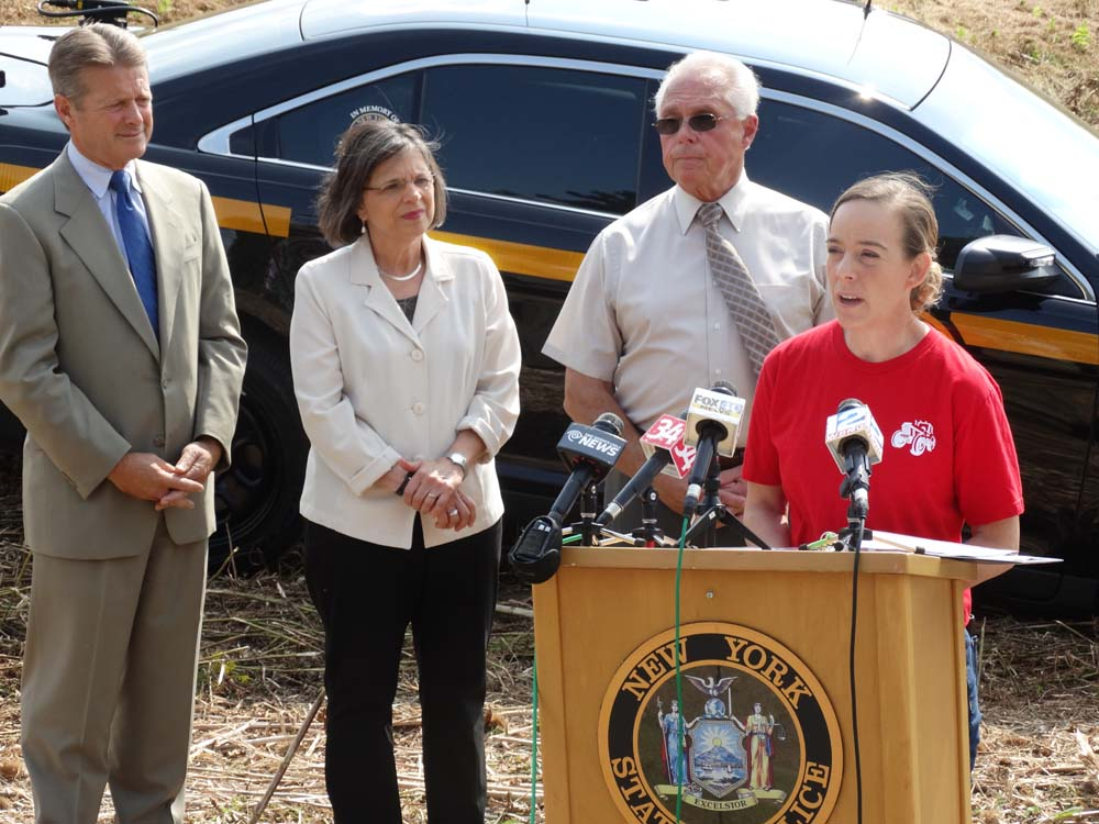 August 31, 2015 – Assemblywoman Lupardo joins Senator Pat Gallivan and Assemblyman Cliff Crouch as fallen State Trooper Christopher Skinner's sister Julie offers remarks at the dedication of two bridg