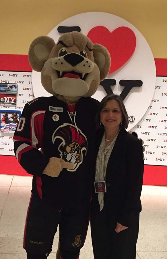November 18, 2015 – Assemblywoman Lupardo with Binghamton Senators' mascot Max at the annual Tourism Summit. I Love NY is teaming with the AHL to promote tourism Upstate.
