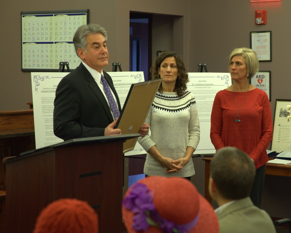 Assemblyman Al Stirpe awards sisters Melinda Sorrentino and Melissa Spicer, founders of Clear Path for Veterans, with his 2014 Women of Distinction Award.