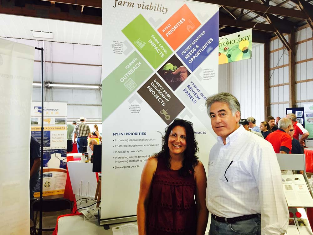 Assemblyman Stirpe at Empire Farm Days speaking with Julie Suarez, Assistant Dean, College of Agriculture and Life Sciences at Cornell University.