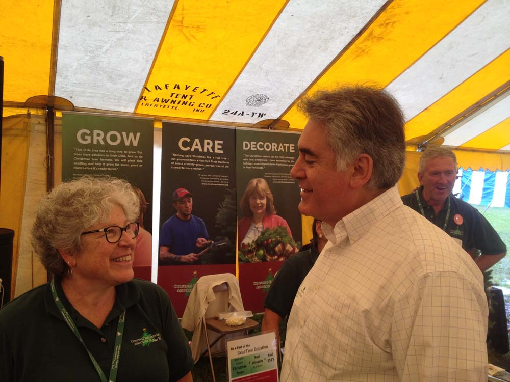 Assemblyman Stirpe speaks with Mary Jeanne Packer, Executive Director of the Christmas Tree Farmers Association of New York at Empire Farm Days