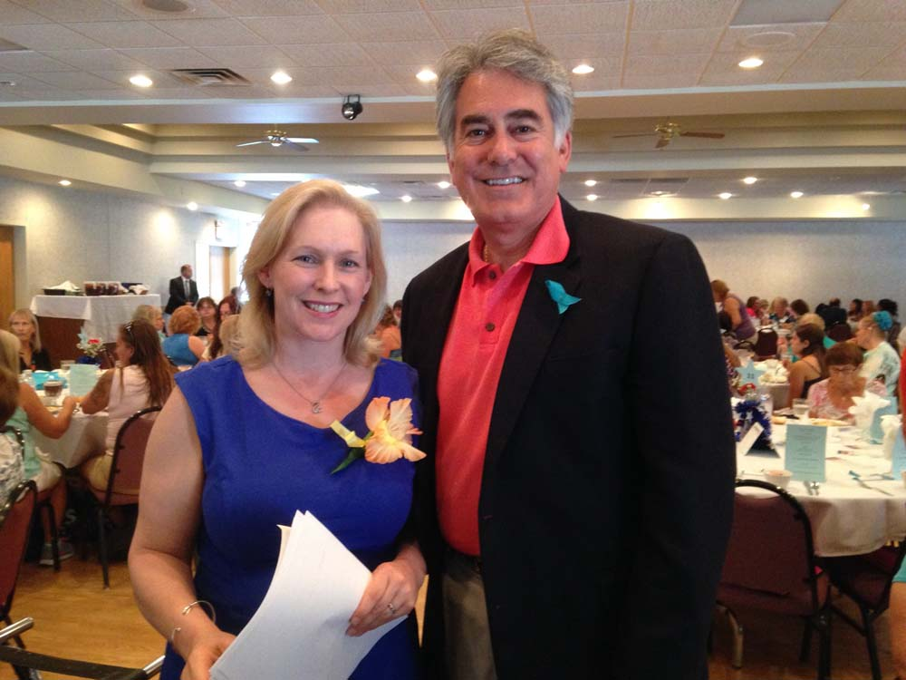 Assemblyman Al Stirpe with U.S. Sen. Gillibrand at the State Fair�s 2015 Women�s Day Luncheon.