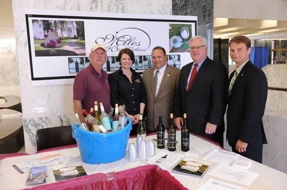 Scott Osborn, President of Fox Run Vineyards; Suzy Hayes of Miles Wine Cellars; Assemblyman Phil Palmesano (R,C,I-Corning); Sen. Tom O'Mara; and Assemblyman Christopher S. Friend (R,C,I-Big Flats) at