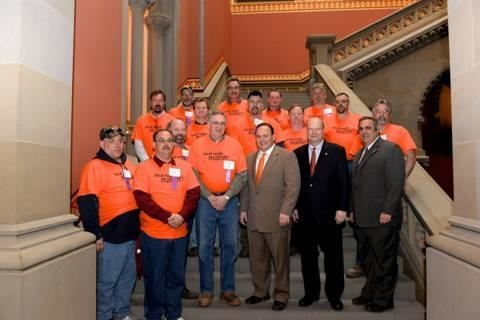 Local town highway superintendents from Steuben County in orange shirts with Assemblyman Palmesano (left, orange tie) Assemblyman Bill Nojay (center) and Assemblyman Joe Giglio (right.