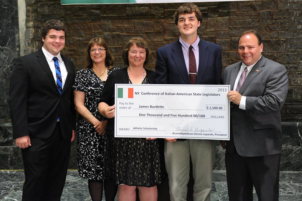 Palmesano with 2013 scholarship winner James Burdette and his family. He accepted a scholarship to attend SUNY Albany.
