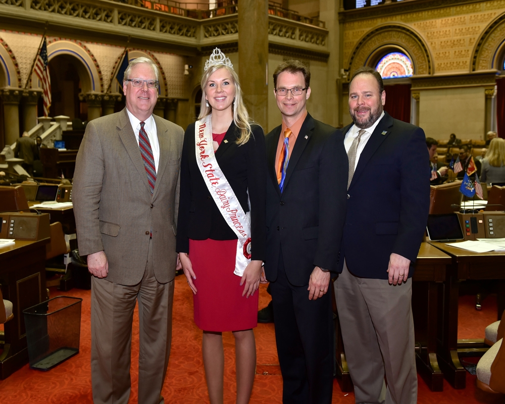 From left to right in the Assembly Chamber: Seantor O'Mara, NYS Dairy Princess Hailey Pipher, Assemblyman Friend, and Assemblyman Palmesano.