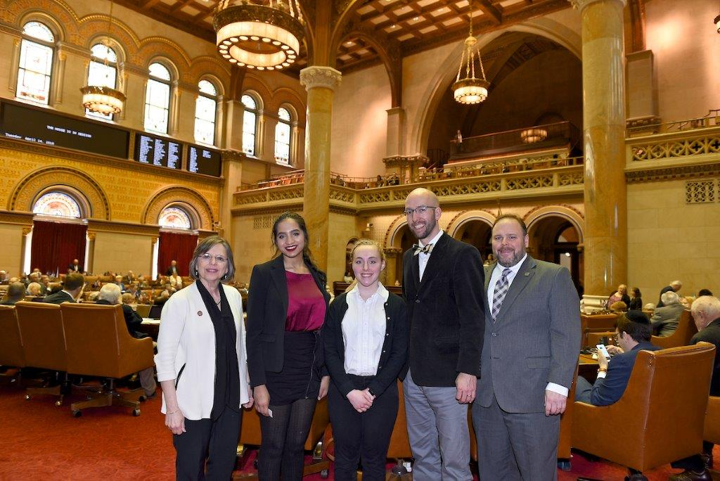 Assemblywoman Donna Lupardo (D-Endwell), Corning Painted-Post High School students Meena Thirumurti and Lauren Thomas, Yearbook and Media Advisor Mike Simons and Assemblyman Phil Palmesano (R,C,I-Corn