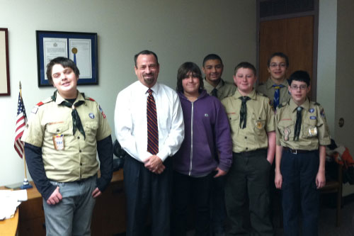 Assemblymember Harry Bronson welcomes Scouts from Troupe 275 of the Seneca Waterways Council as they learn about state government.