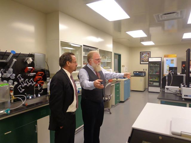 Assemblymember Bronson was invited to tour OyaGen, a local biotechnology company focused on developing drugs for infectious diseases and cancer. [Pictured: Dr. Harold Smith, OyaGen's founder and CEO].