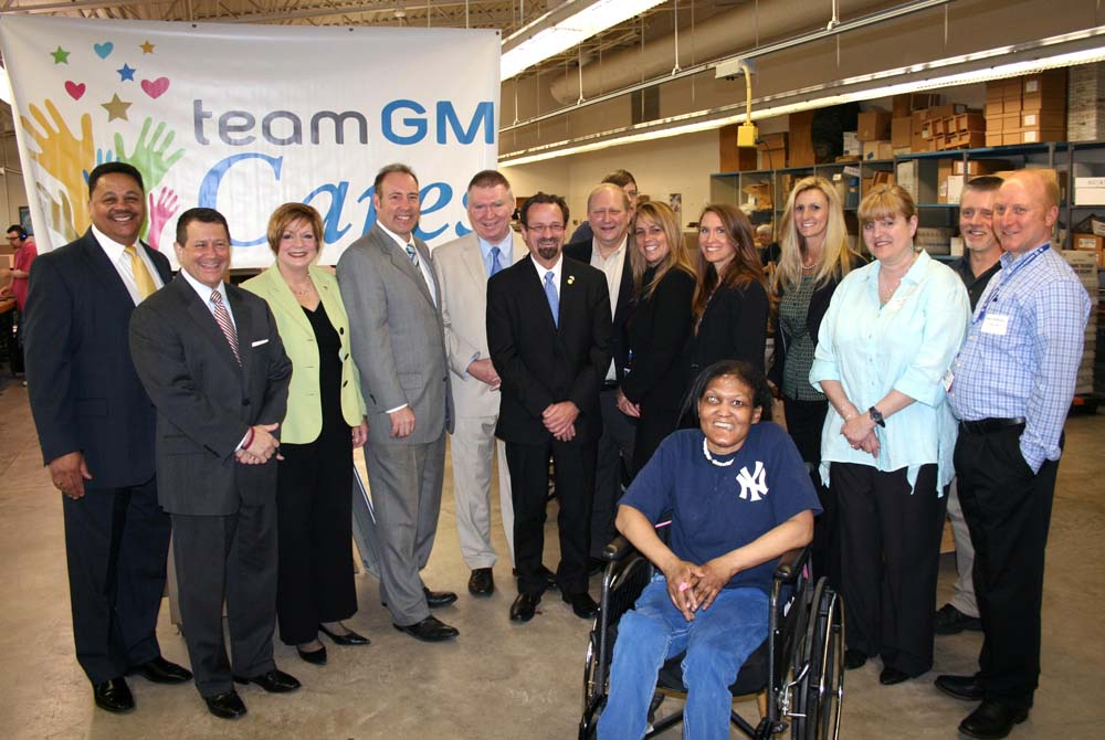 Assemblyman Bronson along with local leaders thanking representatives from General Motors Components-Rochester and United Auto Workers for their generous grant to United Way of Greater Rochester, Holy