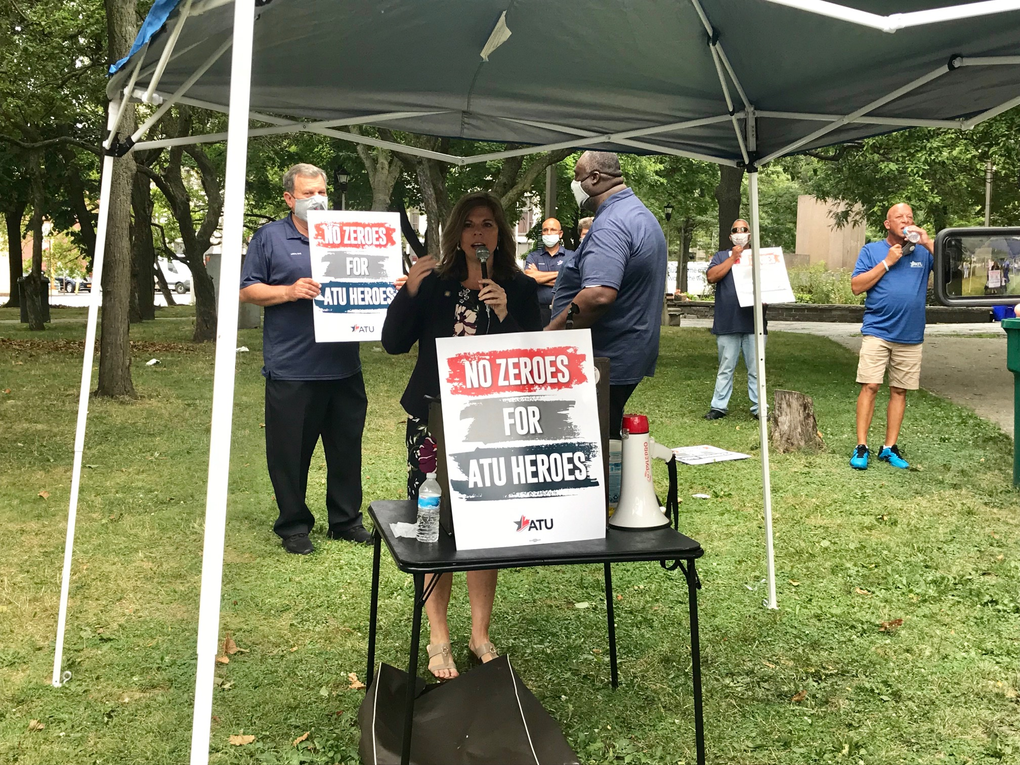 Assemblymember Monica Wallace speaks at an Amalgamated Transit Union rally for safer working conditions for mass transit workers