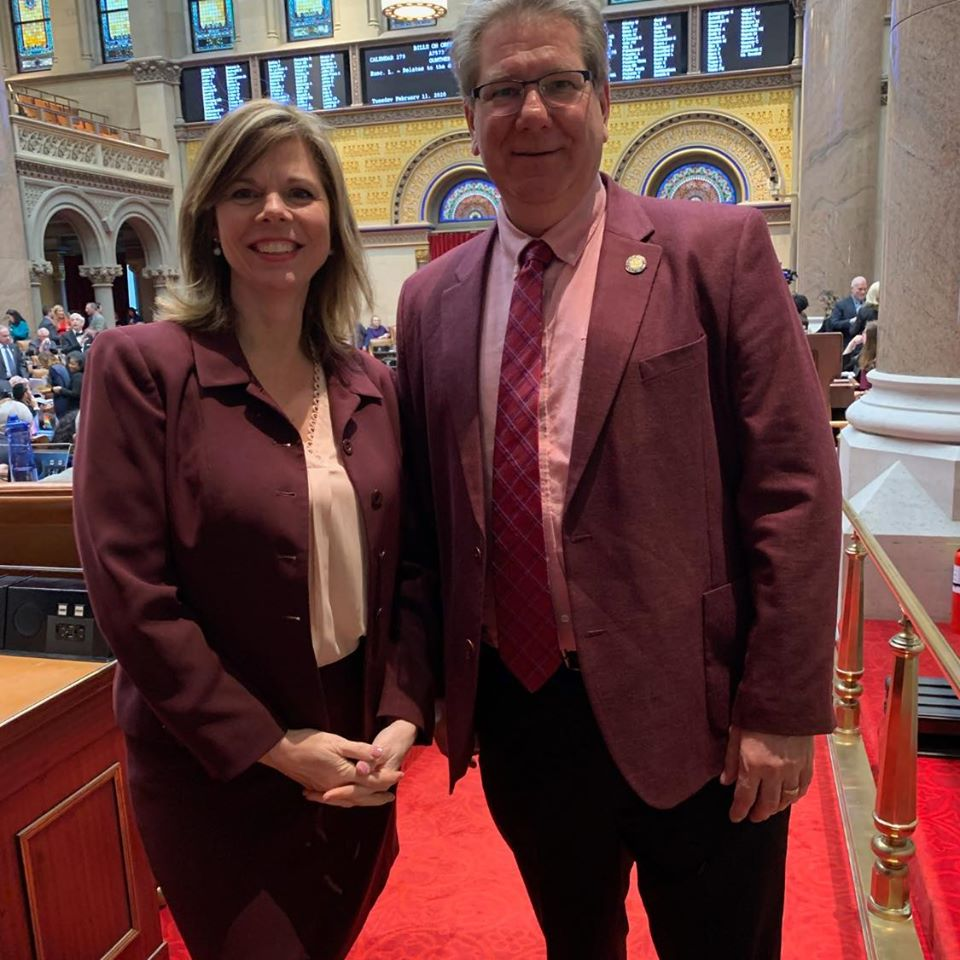 "Assemblymember Monica Wallace ""twinning"" with Assemblymember Michael DenDekker in Albany."