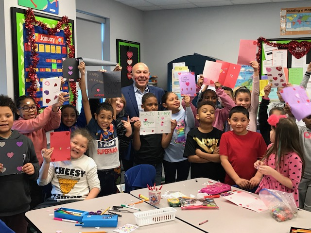 Assemblyman Angelo Morinello (R,C,I,Ref-Niagara Falls) and 3rd grade students from Niagara Street Elementary School in Niagara Falls show off their valentine cards.