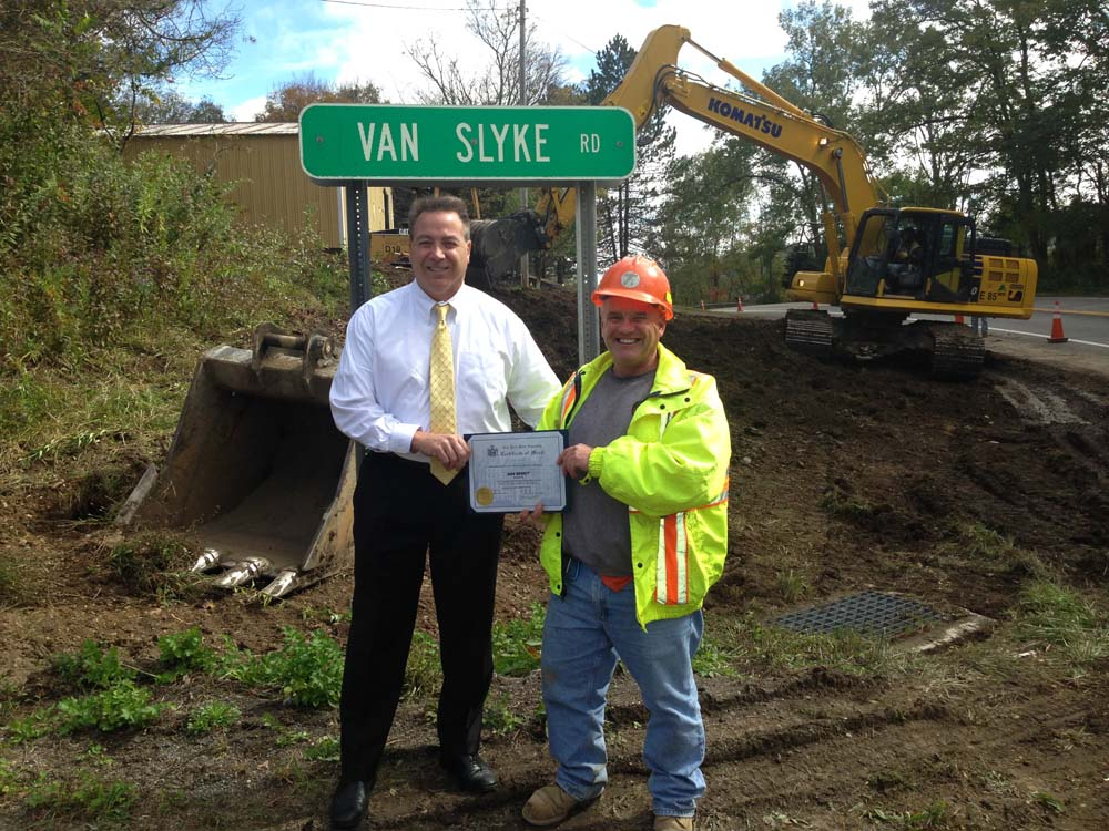 Assemblyman David DiPietro (R,C-East Aurora) is seen awarding a Citation to DOT Engineer Dan Bierut for going above and beyond the call of duty for creating a line of sight at the intersection of Rout