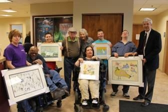Pictured here, left to right, Terrill (Terri) Lair � Art Facilitator, Henry Wesley, Eric Barmore, Harry LaVoice, Sara Michalak � Art Facilitator, Brennan Ryel, Daniel Whitford, Eric Morrison and Assemblyman Goodell.